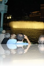 Men balding while watching the Bellagio Fountains