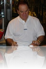 Pete Rose at Caesars signing baseballs