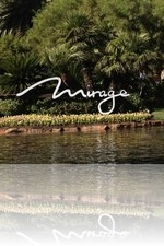 The Mirage Sign with the Casino in the background